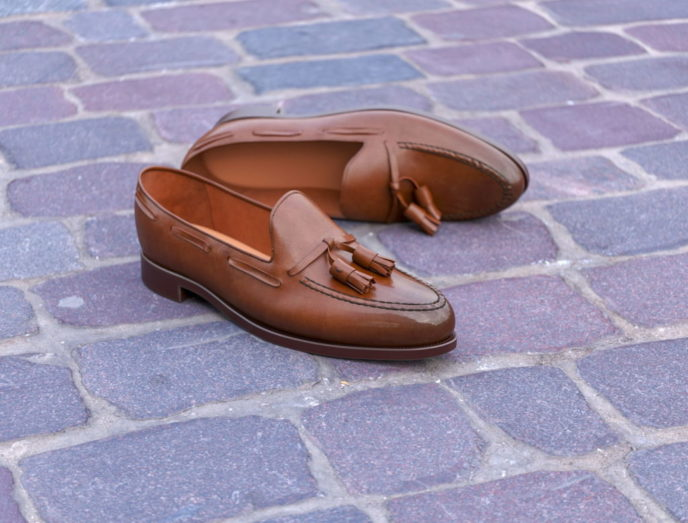 3D Rendered Leather Shoes On A Pavement