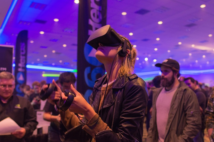 A Visitor of a Product Trade Show with a VR Headset On