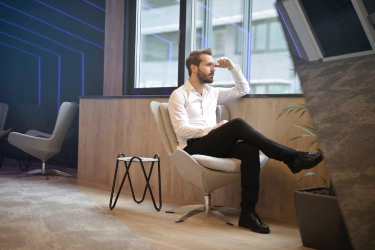 3D Marketing Specialist Sitting on a Chair by the Window