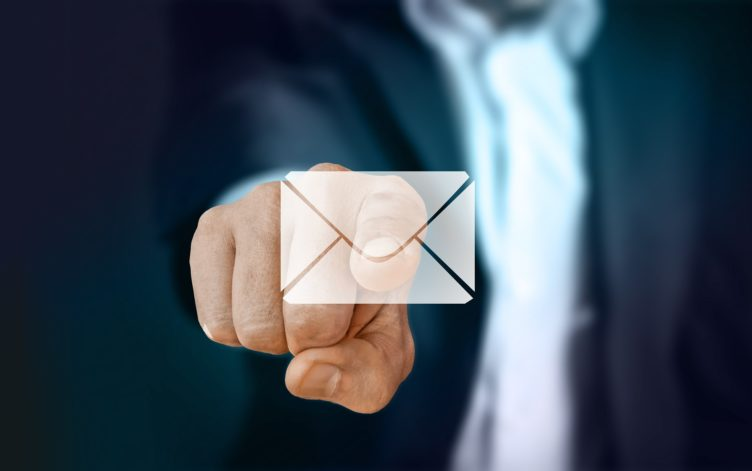 A Businessman Pointing to an Electronic Letter Icon